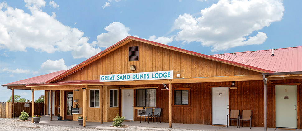 The Great Sand Dunes Lodge sign hung above the entrance to the office.